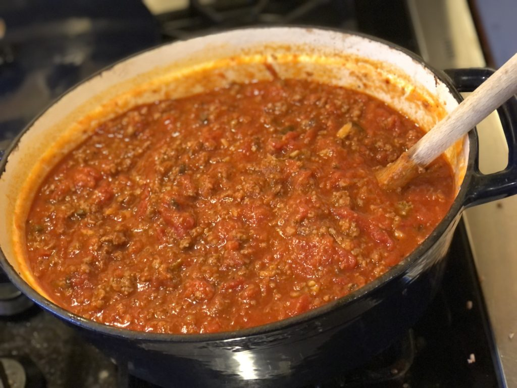 Super Meaty Spaghetti Sauce from Farmwife Feeds uses jarred sauce, mushrooms, hamburger and sausage for a sauce that tastes completely homemade.