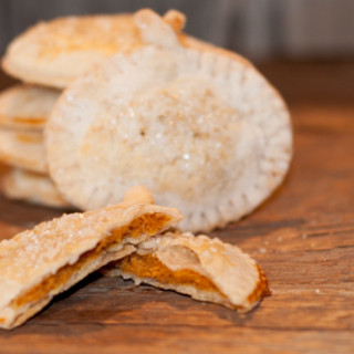 Individual Pumpkin Hand Pie are so easy to make, cute and the perfect little treat to top off your Thanksgiving feast.