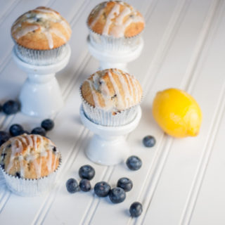Easy Lemon and Blueberry Muffin Recipe using a box mix with a tart lemon glaze!