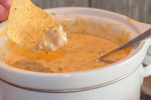 Crock Pot Chili Con Queso Dip with just three ingredients is always a crowd pleaser.