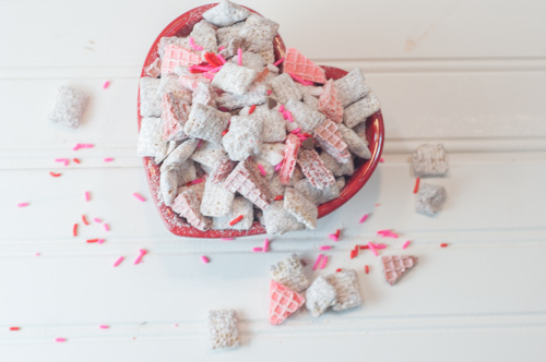 A million versions of Puppy Chow and this Cherry Chip Puppy Chow is my favorite, made with white chocolate, cherry chip cake mix and sugar wafers!