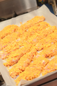 These Cheesy Chicken Tenders are a go to comfort food here! Moist with a cheesy crunchy cornflake coating!