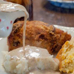Fried Chicken and Skillet Gravy from Farmwife Feeds is just like Grandma's Sunday Dinner #recipe #castiron #chicken #friedchicken