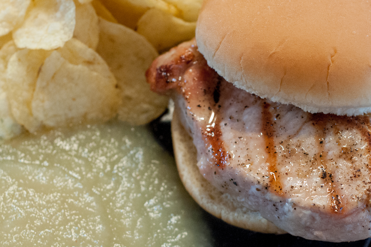 Simple Grilled Pork Chop Sandwiches from Farmwife Feeds - add a bag of chips and applesauce and it's a full healthy easy to prepare meal. #pork #sandwich #fullmeal #recipe #grill