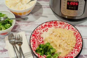 Instant Pot Chicken and Noodles from Farmwife Feeds, all the flavor of cooked all day richness in a lot less time. #chicken #recipe #instantpot #comfortfood