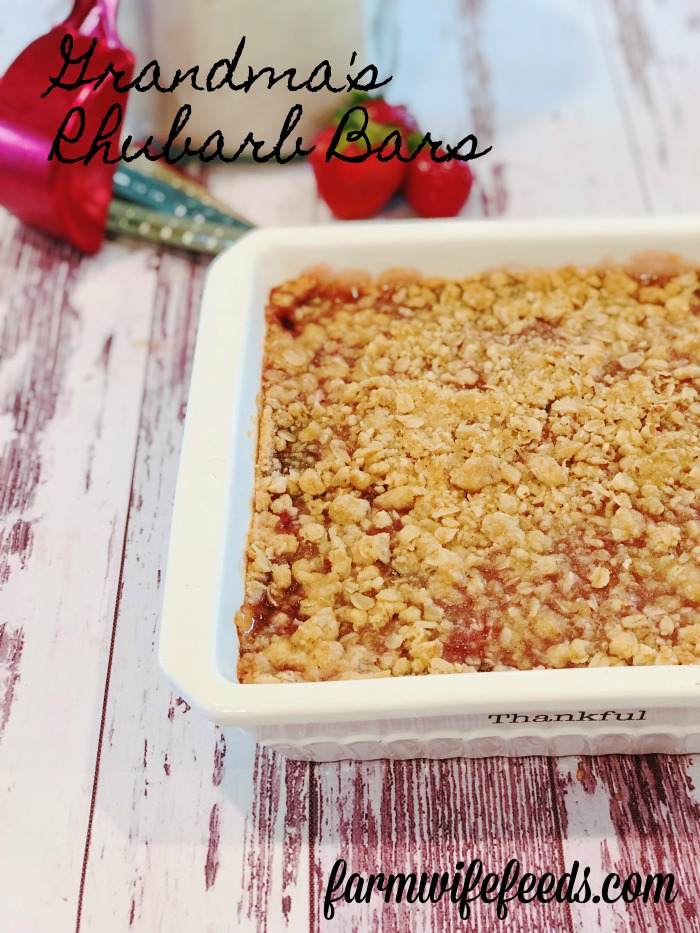 Grandma's Rhubarb Bars from Farmwife Feeds with a touch of strawberry jam is a great dessert for pitch-ins and get togethers. #rhubarb #recipe #bardessert