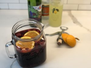 Semi-Sweet Red Wine Sangria from Farmwife Feeds, fruity wine with Triple Sec and Lemoncello made by the pitcher! #sangria #redwine #drinks