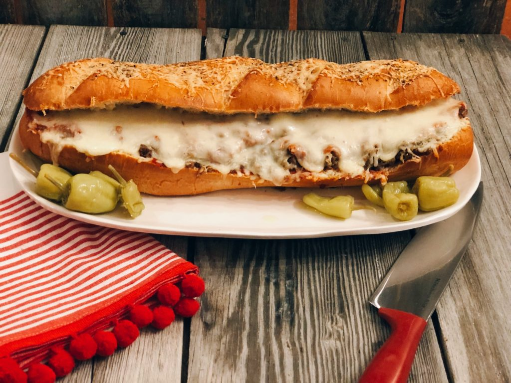 Easy Stromboli Sandwich from Farmwife Feeds, a family size sandwich that is simple to make and customize anyway your family likes. #recipe #grinder #sandwich