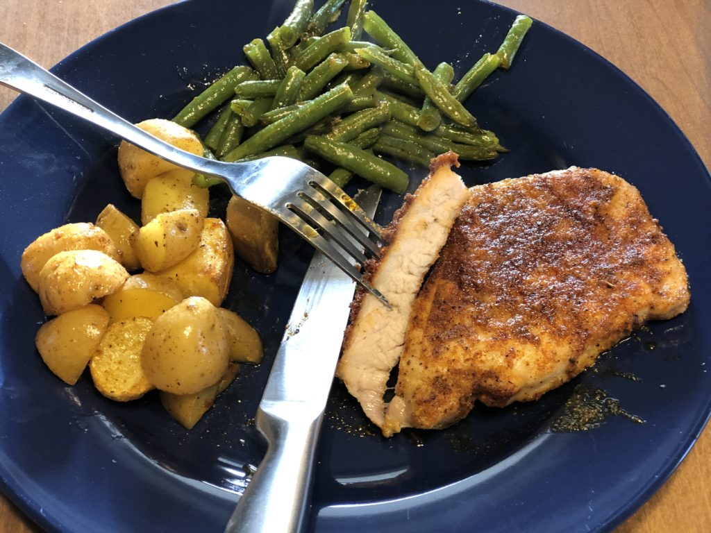 Sheet Pan Pork Chop Dinner from Farmwife Feeds is a one pan, 5 minute prep meal to feed the whole family. #pork #onepan #sheetpandinner