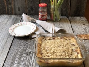 Strawberry Rhubarb Cheesecake Crisp from Farmwife Feeds is everything the name says all in one delicious dish. #crisp #strawberry #cheesecake #dessert #rhubarb