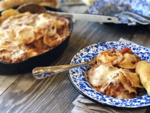 Easy Ravioli Casserole from Farmwife Feeds is a hearty meal that is ready in less than 30 minutes or can be prepped ahead for busy nights.