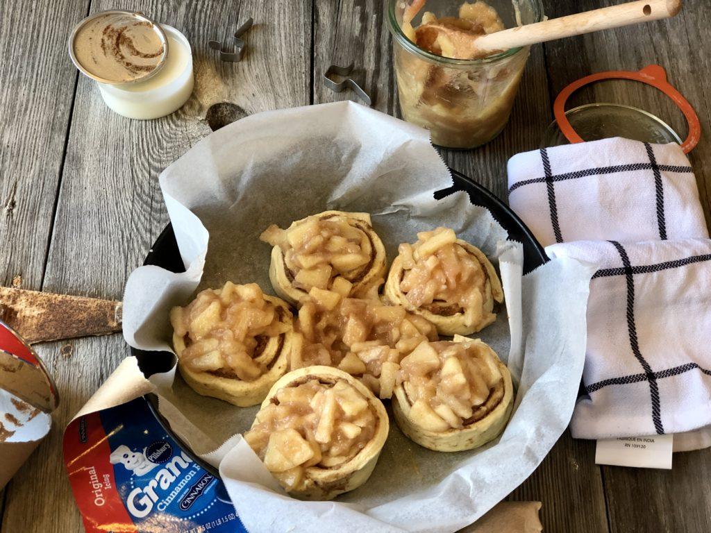 Easy Peasy Apple Pie Cinnamon Rolls from Farmwife Feeds taste like homemade, the perfect way to make semi-homemade for a delicious treat everyone will love. #cinnamonrolls #breakfast #semihomemade #applecinnamonrolles