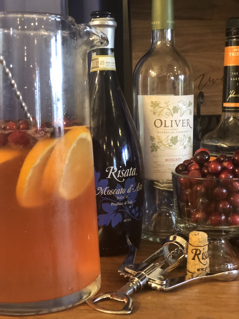 Sparkling Cranberry Sangria from Farmwife Feeds, cranberries and oranges flavor moscato topped off with your favorite bubbly. #sangria #wine #cocktail